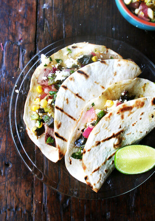 I served this grilled pablanos salsa with grilled, diced New York Strip steak, but skirt, hanger or flank would be really nice, too. And while meat, especially with occasions like Father's Day in mind, feels like a must, with this salsa on the table, I find myself forgetting the meat altogether, loading up tortilla after tortilla with as much salsa as each can bear, piling on diced avocado and dollops of sour cream. Never have tacos disappeared so quickly. // alexandracooks.com
