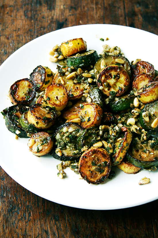 This sautéed zucchini recipe is one of the most delicious things I've made in awhile. What I love about the dish is that even though the dressing is a jumble of ingredients, you can taste each element — the bite of the vinegar, the zing of the garlic, the sweet herbs, the crunchy nuts. // alexandracooks.com