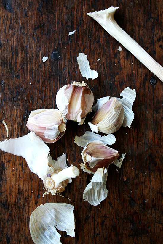 A head of garlic split into cloves.