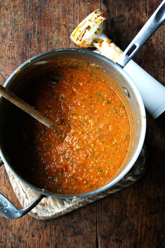 In this roasted tomato and bread soup, slow-roasting the tomatoes, onions, carrots and garlic concentrates all of the flavors, making any liquid but water unnecessary. I have no doubt this soup will make an impression in your heart and mind. // alexandracooks.com