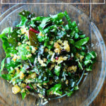 A plate of Swiss chard salad with parmesan and breadcrumbs.