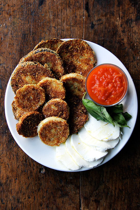 These crispy rounds of eggplant parmesan are irresistible, and with a few slices of cheese, some bread, sauce, maybe some prosciutto or other cured meats, you can make a meal out of them. Little ones, teary eyed or otherwise, seem to like them, too. // alexandracooks.com