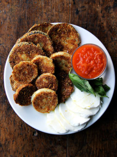 A plate of crispy eggplant rounds.