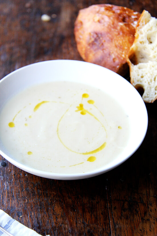 Soup season has officially arrived, bringing with it bowls of warm, comforting goodness, smells that permeate the house, the nourishment we crave on chilly days, and blisters to our little, out-of-practice fingers. This parsnip pear soup is perfect for this time of year. // alexandracooks.com