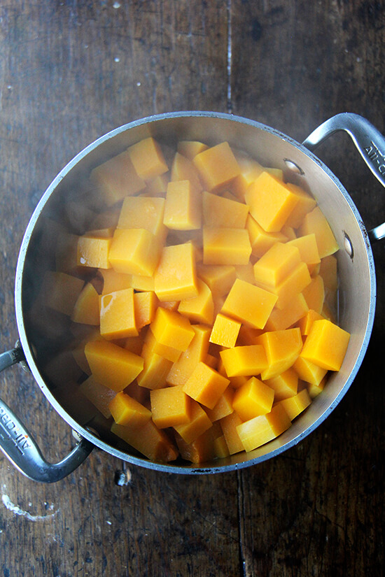 A soup pot with steamed squash.