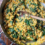 A pan of farro risotto with roasted butternut squash and kale.