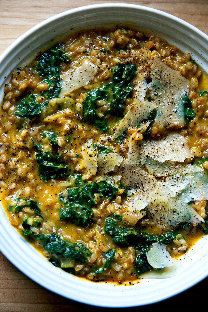 A bowl of farro risotto with butternut squash and kale.
