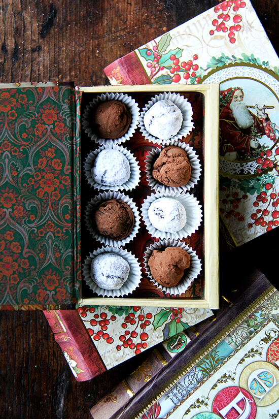 A decorative box holding homemade chocolate truffles.