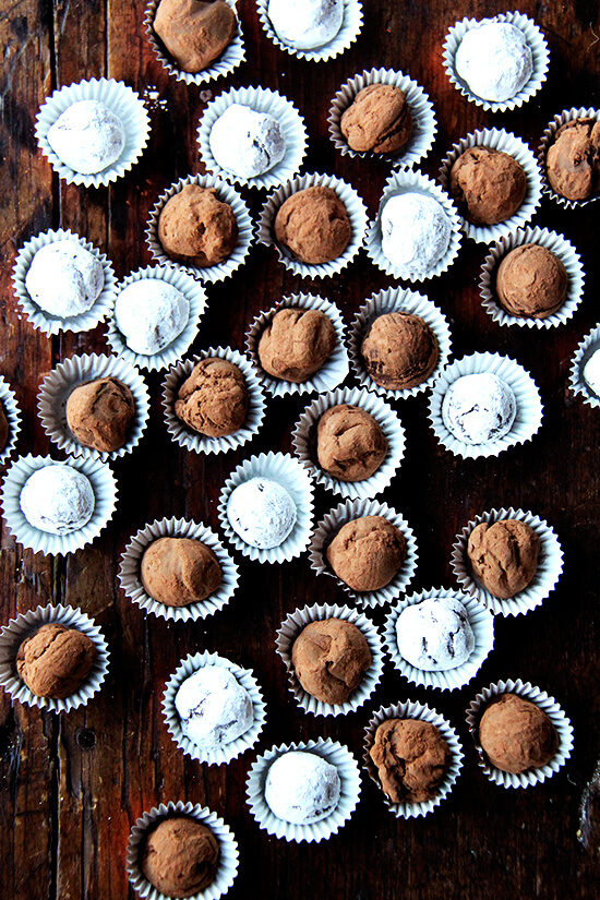Overhead shot of boozy chocolate truffles on a table.