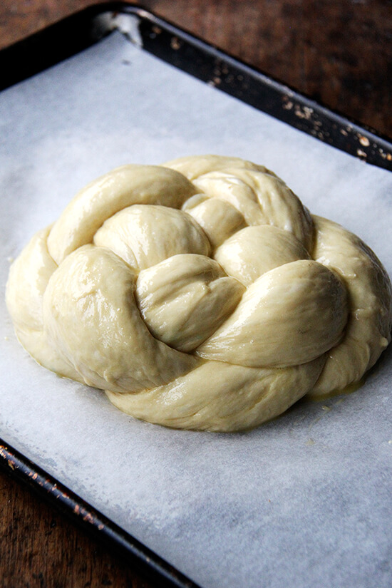 egg-washed circle challah on sheet pan