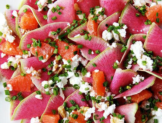 Watermelon radish salad with goat cheese, orange, and walnuts.