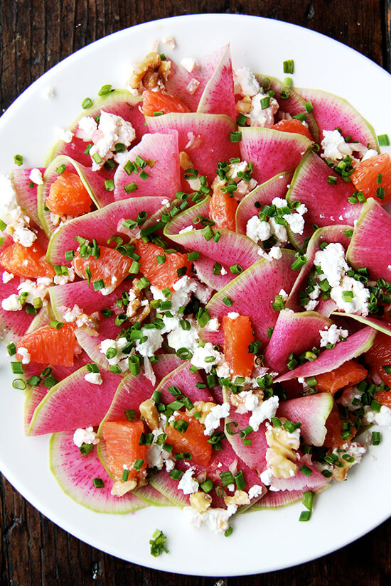 Watermelon radish salad with goat cheese, oranges, and walnuts.