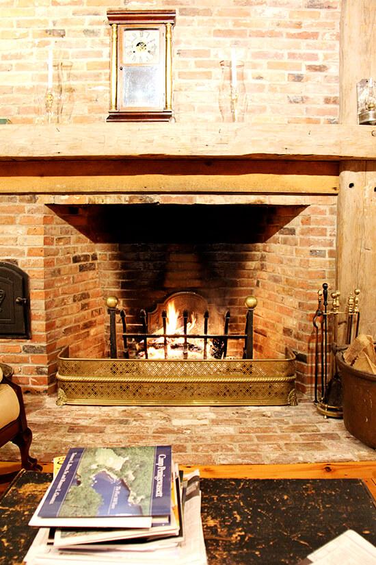 A roaring fire in a brick fireplace.