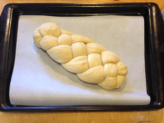 Holly's challah on a sheet pan, ready for the oven