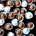 Boozy chocolate truffles on a table.