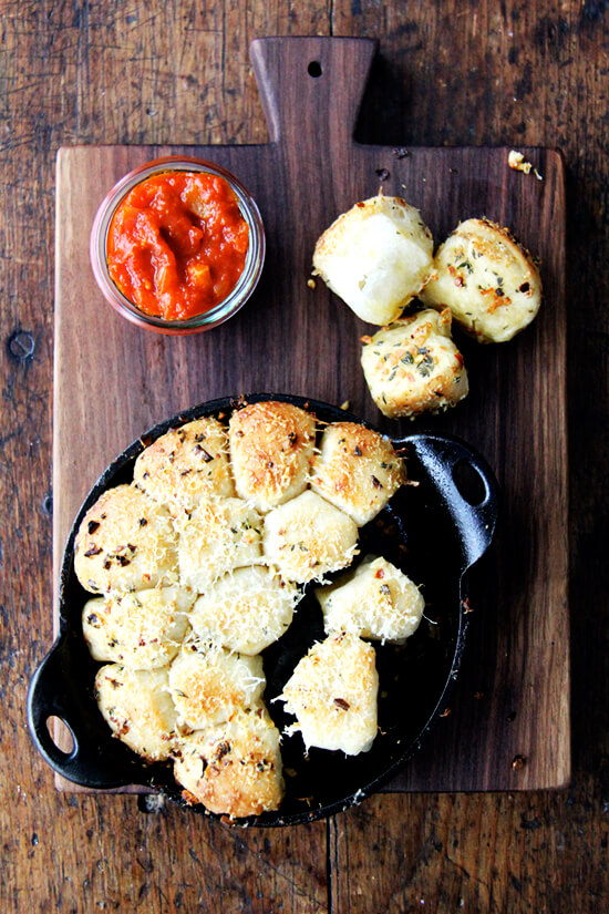 This garlic and thyme monkey bread with spicy tomato sauce would nicely complement any pasta dish (for all of you carb lovers that is) but would also be wildly received at any sort of Super Bowl gathering. // alexandracooks.com