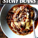 A bowl of slow cooker beans over polenta.