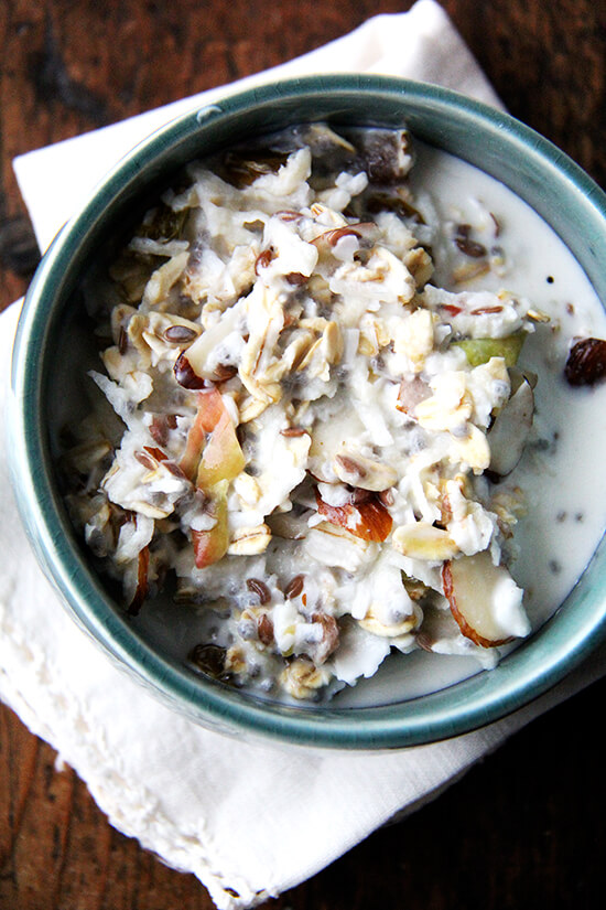 There are countless ways to make Bircher muesli, but the basic idea is that you throw raw oats, nuts, and dried fruit into a bowl and soak them in milk. It's so nice having an enormous vat, hideous storage container and all, of muesli sitting on my counter — truly, I feel lost in the morning when we are out. // alexandracooks.com
