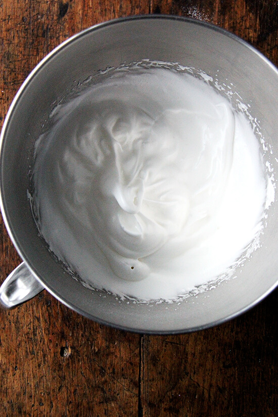 beaten egg whites in a bowl
