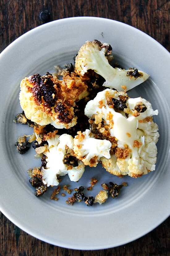 Minimal ingredients, minimal hands on time, this whole-roasted cauliflower with fried capers and brown butter breadcrumbs is a winner. The cauliflower emerges from the oven knife tender but not mushy. Here, the head's edges crisp and caramelize both from the heat of the oven and the oil pooling in the bottom of the pan, and the nutty crumbs and burst capers that nestle in the web of stems and spill all around the serving platter couldn't be more irresistible. // alexandracooks.com