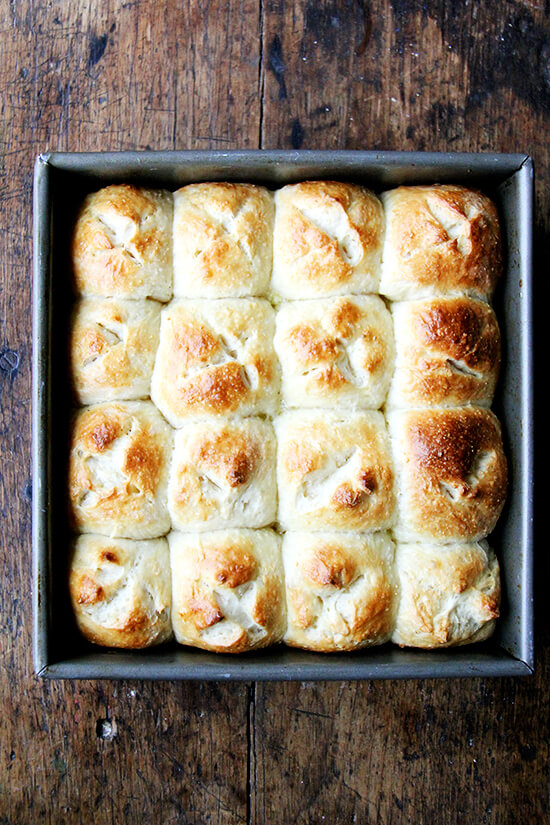 These hot cross buns can be mixed and baked in the same day, but isn't it more fun to pull a pan from the fridge, pop it in the oven, and relax with the paper while the smell of freshly baked sweet buns fills the air? // alexandracooks.com