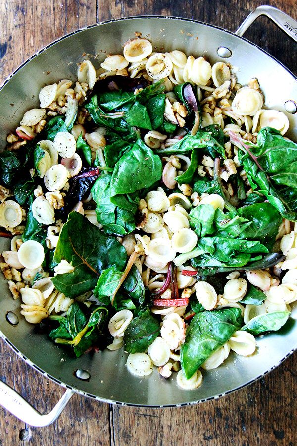 in pan with brown butter and walnuts
