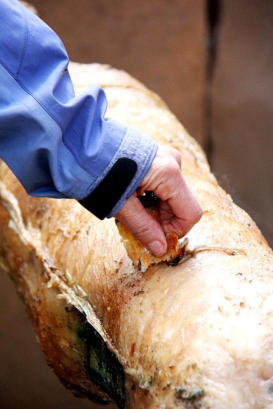 Rubbing lamb with bread