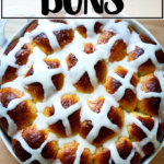 Hot cross buns, freshly glazed with icing.