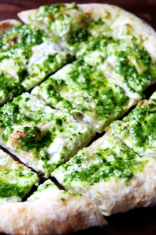 In this pesto pizza, while the pizza isn't baked completely naked, the process is similar: scatter cheese lightly across dough, drizzle it with olive oil and bake it until bubbling. Immediately upon pulling it from the oven, brush it with a thinned-out ramp pesto and a sprinkling of sea salt. Withholding the pesto from the pizza until it's out of the oven preserves not only its sharp, punchy flavor but also its vibrant green color. // alexandracooks.com