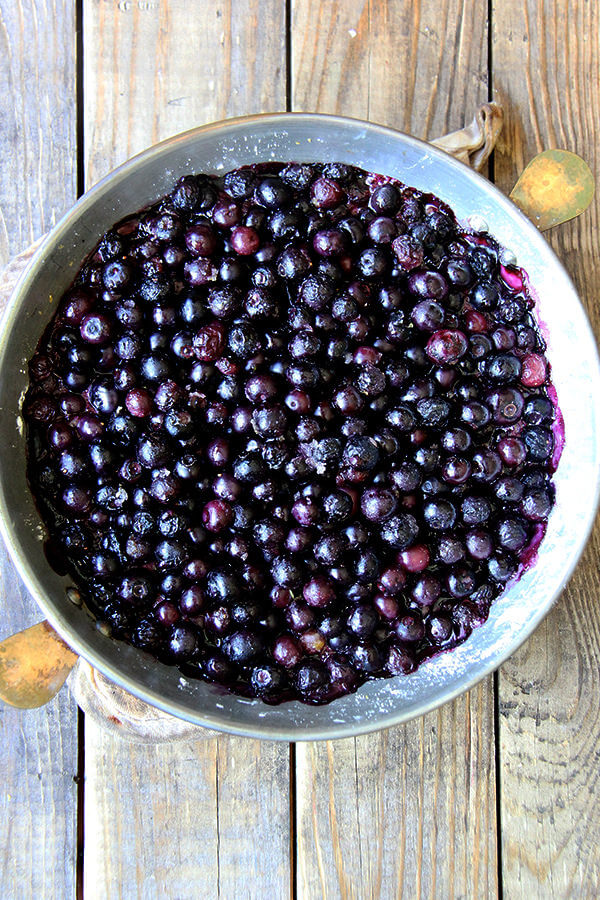 A pie plate with baked blueberries —step 3 of blueberry cobbler recipe.