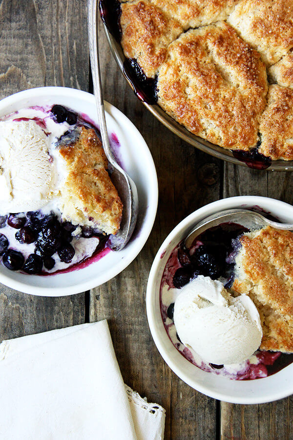 Bowls of blueberry cobbler with ice cream.