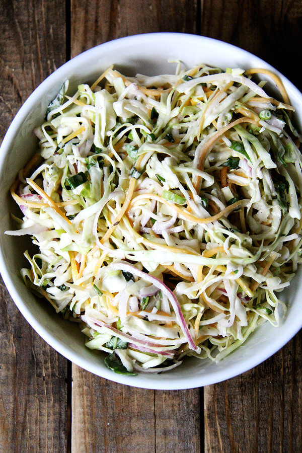 This is my favorite recipe for buttermilk dressing, which I love for slaw — so much lighter than mayonnaise-based dressings, and delicious, too: vinegar, Worcestershire, and hot sauce give it a nice kick/bite. To put it all together, I used cabbage, basil, cilantro, scallions, and two turnips as well as a couple of carrots. // alexandracooks.com