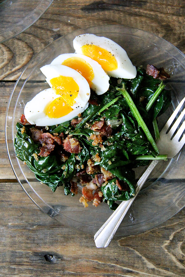 This warm spinach salad calls for gently wilting the spinach in a stainless steel bowl set over simmering water. Cool, right? And bacon and breadcrumbs make everything better. Am I right? // alexandracooks.com