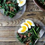 Warm spinach salad on a plate.