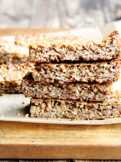 In these granola bars, I use oats, coconut, almonds and millet for the dry ingredients, the same makeup as the granola. For the glue, I use coconut oil or butter, maple syrup, brown rice syrup and almond butter. They hold their shape at room temperature and have thus become a lunch box staple. // alexandracooks.com