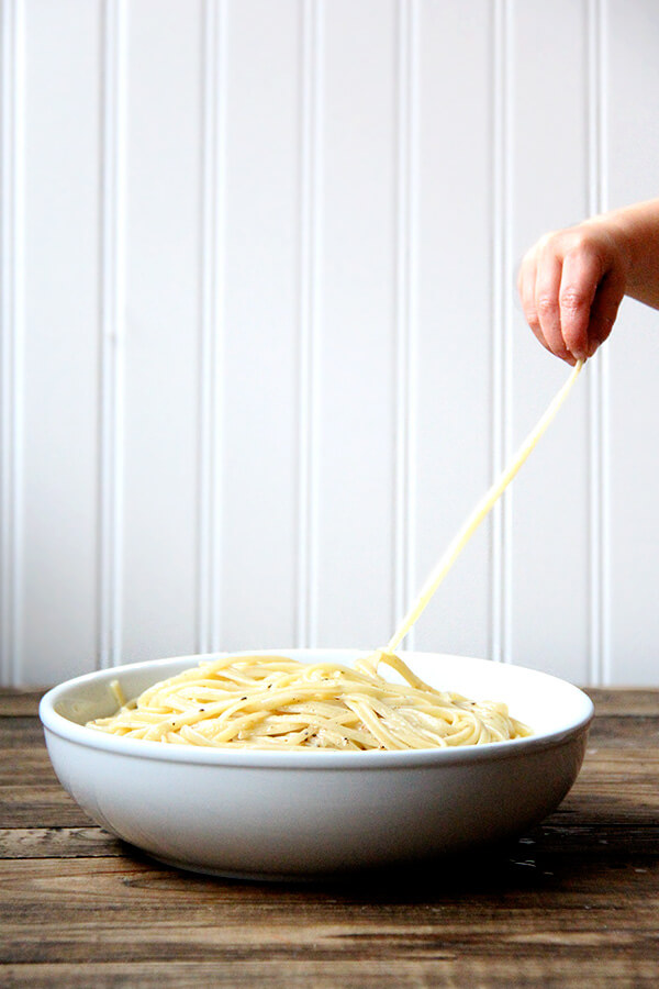 Cacio e pepe, a classic Italian dish, relies on starchy pasta cooking water to form a creamy emulsion with butter and cheese, often Parmigiano Reggiano and Pecorino Romano, and it couldn't be more delicious or simple. I like simple. // alexandracooks.com