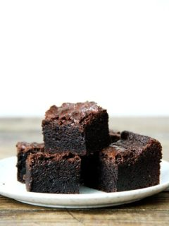 A stack of the best ever fudgy brownie recipe on a plate.