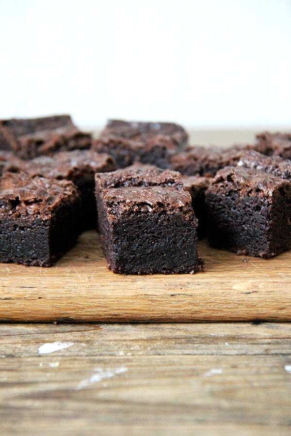 Side view of cut brownies on a board.