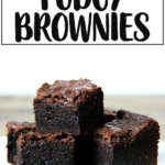 A pile of the best ever rich fudgy brownies on a plate.