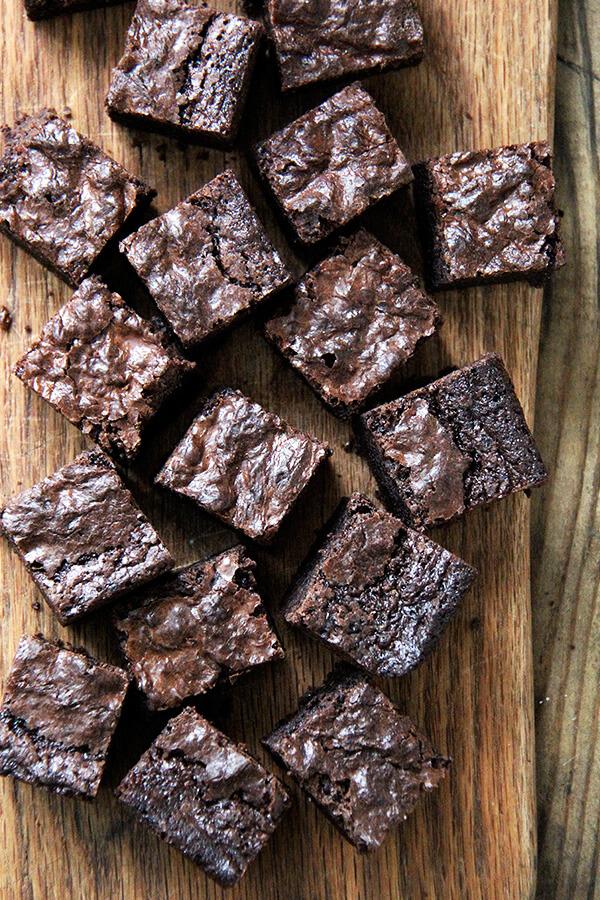 An overhead shot of cut, rich, fudgy brownie recipe on a board.