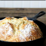 A cast iron skillet filled with Irish soda bread.