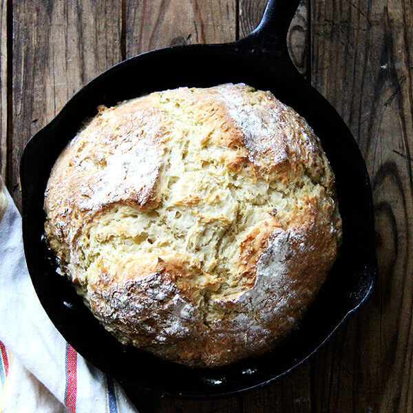 A cast iron skillet of just-baked Irish soda bread.