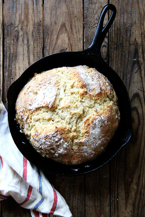A cast iron skillet with freshly baked Irish soda bread.