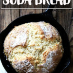 A just-baked loaf of Irish Soda Bread in a cast iron skillet.