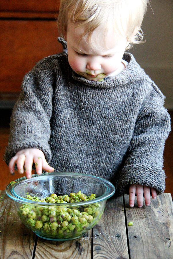 Baby eating cilantro-lime chickpeas.