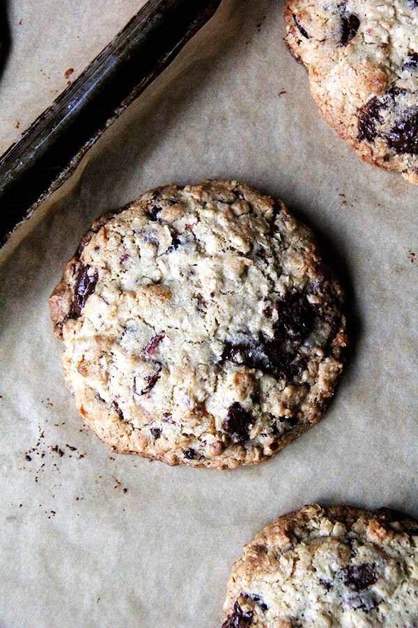 These giant chocolate chip cookies will put to use the many odd bags of nuts, dried fruit, chocolate chips, oats, and coconut flakes cluttering the cupboards. One that might just feed the neighborhood or sustain the kids for hours on a summer camping trip. // alexandracooks.com