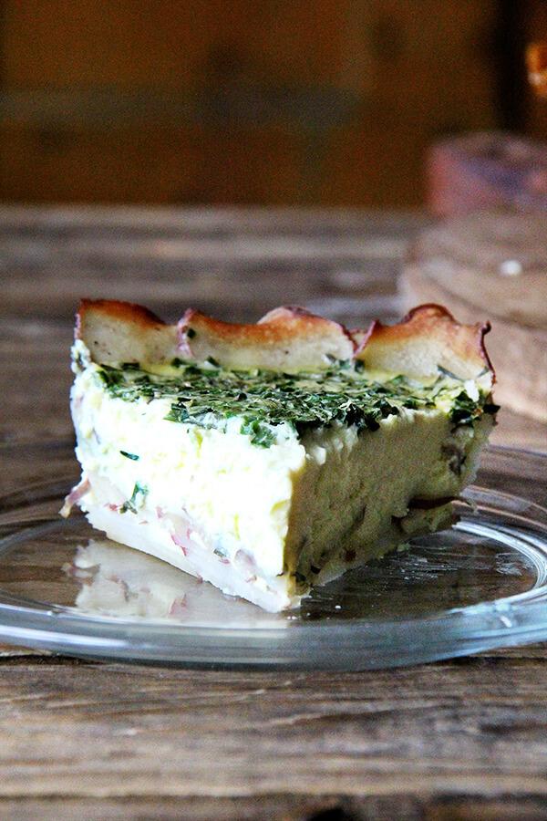 A slice of potato-crusted quiche.