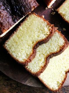 A sliced loaf of lemon semolina cake.