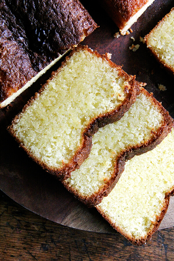 A sliced loaf of lemon semolina cake.