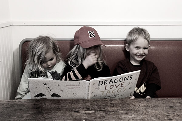 Kiddos reading Dragons Love Tacos.